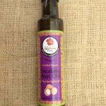 8.5 fl oz bottle of organic macadamia nut oil